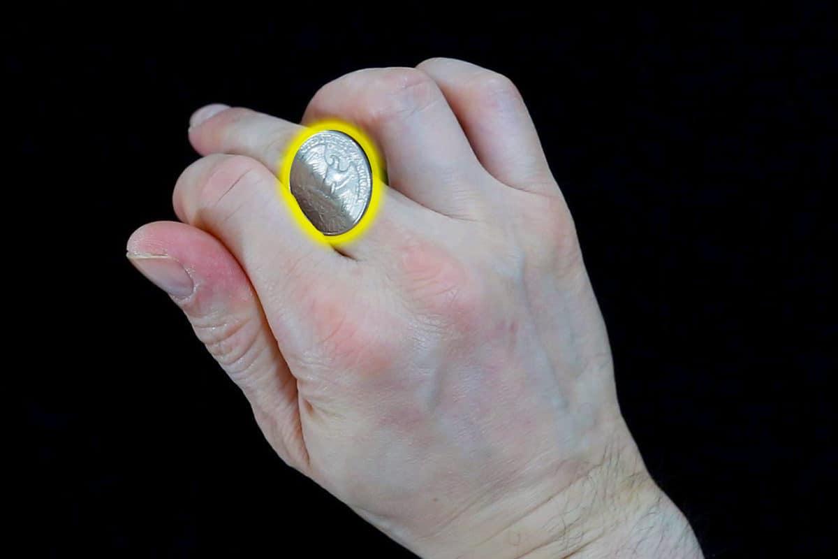 coin across knuckles
